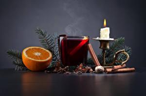 Картинки Рождество Свечи Апельсин Бадьян звезда аниса Корица Напитки Ветки Стакан Еда