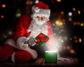 Фотография Рождество Дед Мороз Шапки Подарки