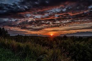 Обои Аляска Рассветы и закаты Небо Вечер Пейзаж Облака Трава Солнце Wasilla Природа фото