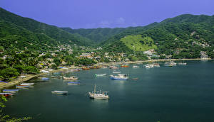 Обои Колумбия Побережье Горы Лодки Дома Катера Природа фото