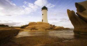 Обои Италия Маяки Небо Камни Вода Sardinia Природа фото