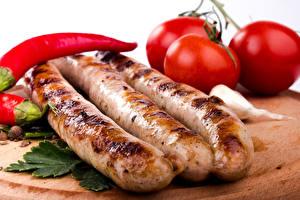 Обои Мясные продукты Сосиска Помидоры Еда фото