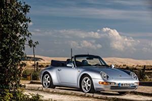 Фотографии Porsche Серебристый Кабриолет 1994-98 911 Carrera 3.6 Cabriolet Автомобили