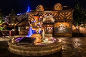 Картинка Штаты Диснейленд Парки Фонтаны Дома Скульптуры Калифорния Анахайм Ночные