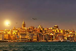 Картинка Стамбул Турция Здания Река Рассветы и закаты Солнце Города