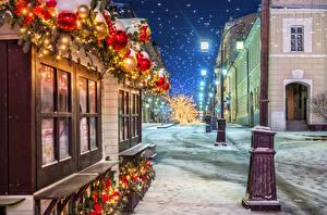 Фотографии Москва Рождество Россия Зима Снег Улица Уличные фонари Ночь Manezhnaya Square Города