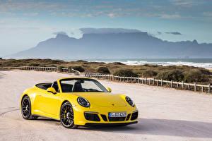 Картинка Порше Желтый Кабриолет Металлик 2017 911 Carrera 4 GTS Cabriolet Worldwide (991) Авто