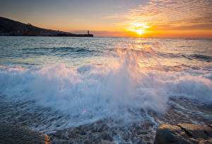 Обои Море Рассветы и закаты Волны Небо Солнце Природа фото