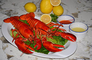 Фото Морепродукты Раки Лимоны Две Тарелка Пища