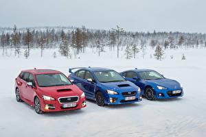 Фото Субару Зимние Втроем Снег Автомобили