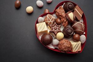 Обои Сладости Конфеты Шоколад Цветной фон Еда фото