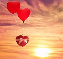 Фотографии День святого Валентина Небо Вечер Воздушных шариков Сердца 2 Бантик