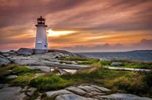 Обои Канада Маяки Рассветы и закаты Побережье Камни Небо Трава Peggys Point Lighthouse Природа фото