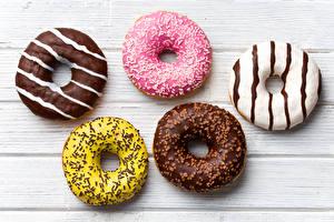 Обои Пончики Сладости Шоколад Сахарная глазурь Доски Продукты питания