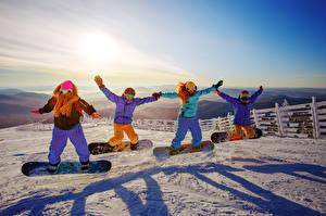 Фотография Сноуборд Снег Куртка Очки Прыжок