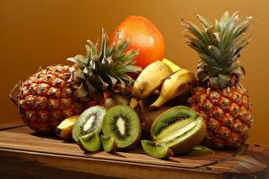 Картинка Фрукты Ананасы Киви Бананы Апельсин Продукты питания
