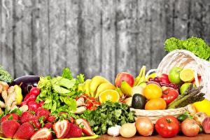 Фото Фрукты Овощи Томаты Лук репчатый Клубника Лимоны Еда