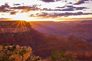 Фотография Гранд-Каньон парк США Парки Горы Рассветы и закаты Небо Облака Лучи света Природа