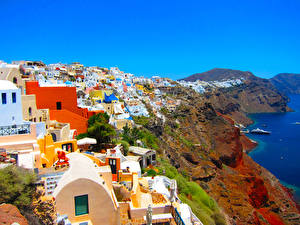 Картинки Греция Дома Побережье Санторини Скале Города