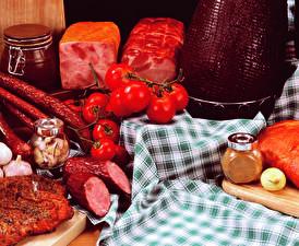 Обои Мясные продукты Колбаса Ветчина Помидоры Еда фото