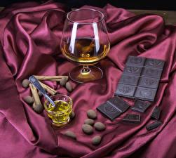 Фотографии Натюрморт Алкогольные напитки Шоколад Корица Бокалы Пища