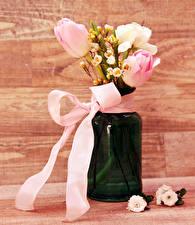 Картинка Букеты Тюльпаны Ваза Бантики цветок