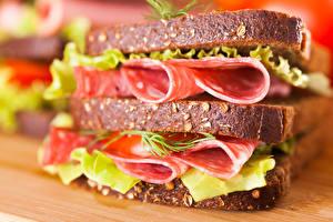 Фото Быстрое питание Бутерброды Хлеб Мясные продукты Макросъёмка Сэндвич