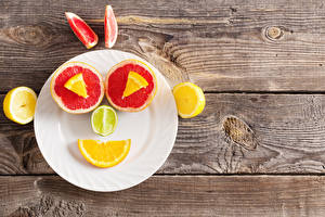 Картинки Грейпфрут Лимоны Смайлики Тарелка Доски Еда