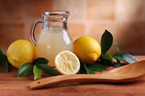 Фото Лимоны Напиток Лимонад Кувшин Ложка Листва Еда