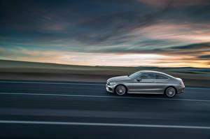 Фотографии Mercedes-Benz Сбоку Едущий Купе 2015 C-Klasse AMG C205 Авто