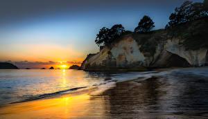 Картинки Новая Зеландия Побережье Рассветы и закаты Скала Hahei Природа