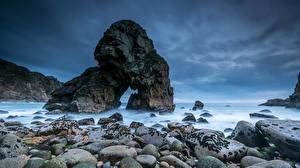 Фото Португалия Берег Камни Небо Скала Природа