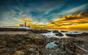 Фотографии Португалия Пейзаж Побережье Маяки Небо Рассветы и закаты Облака Cabo Raso Cascais Природа