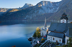 Картинка Горы Берег Австрия Озеро Церковь Халльштатт Альп Lake Hallstatt Города