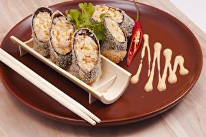 Фотография Морепродукты Суши Рис Доски Пища Палочки для еды