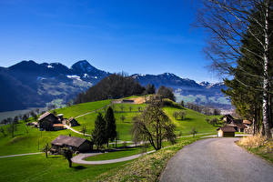 Картинка Швейцария Горы Дороги Луга Здания Деревья Schwyz