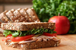 Картинка Бутерброды Вблизи Помидоры Ветчина Хлеб Сэндвич Пища