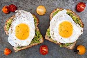 Фотографии Бутерброды Томаты 2 Яичница Пища