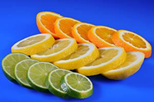 Картинка Цитрусовые Лимоны Апельсин Цветной фон Нарезанные продукты