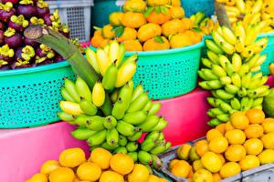 Фотографии Фрукты Бананы Много Цитрусовые Еда