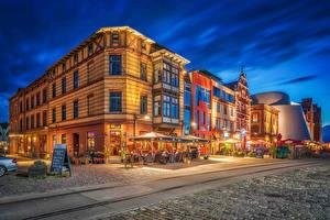 Обои Германия Дома Вечер Дороги Улица Уличные фонари HDR Stralsund Города