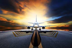 Картинка Самолеты Пассажирские Самолеты Ночь Асфальт Спереди