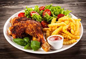 Фото Курица запеченная Картофель фри Овощи Тарелка Кетчуп Еда
