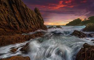 Обои Испания Рассветы и закаты Волны Небо Скала Catalonia Природа