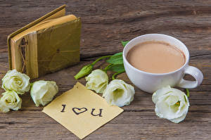 Фотография Натюрморт Лизантус Какао напиток Доски Чашка Книга Цветы