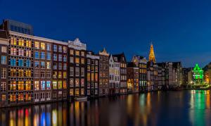 Фотографии Амстердам Нидерланды Здания Водный канал Ночные
