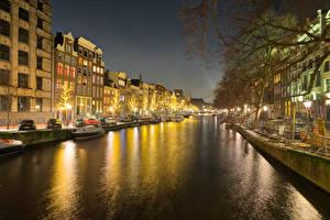 Фотография Амстердам Нидерланды Здания Пирсы Водный канал Ночь