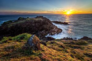 Фотография Австралия Побережье Рассветы и закаты Пейзаж Море Камни Солнце Hat Head National Park