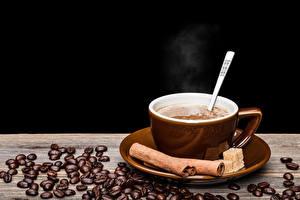 Картинка Напитки Кофе Корица Черный фон Чашка Зерна