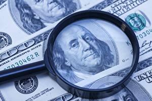 Картинка Деньги Доллары Банкноты Увеличительное стекло 100 franklin